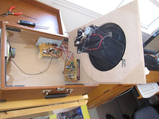Photo shows the Crosley CR249 inside the case. The belt is dangling underneath the pulley.