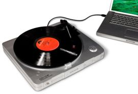 Marketing photo shows the Grace Digital Audio Vinylwriter (AVPUSB01S) USB Turntable from above connected to a laptop via a USB cable.